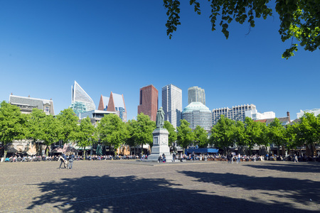 constitutionally: THE HAGUE, NETHERLANDS - MAY 5, 2016: Het Plein (The Square) The Hague is the seat of the Dutch government, parliament, the Supreme Court, and the Council of State, but the city is not the capital of the Netherlands, which constitutionally is Amsterdam. Editorial