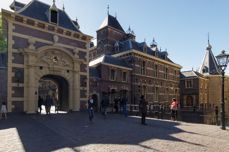 constitutionally: THE HAGUE, NETHERLANDS - MAY 5, 2016:The Hague is the seat of the Dutch government, parliament, the Supreme Court, and the Council of State, but the city is not the capital of the Netherlands, which constitutionally is Amsterdam. Editorial
