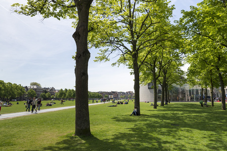 AMSTERDAM, NETHERLANDS - MAY, 15, 2017: Gardens between the Van Gogh museum and the Rijksmuseum on a spring morning