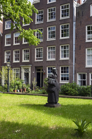 AMSTERDAM, NETHERLANDS - MAY, 15, 2017: The Begijnhof is one of the oldest inner courts in the city of Amsterdam. A group of historic buildings, mostly private dwellings, centre on it.