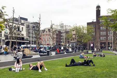 rembrandt: AMSTERDAM, NETHERLANDS - MAY, 15, 2017: Rembrandtplein (Rembrandt Square) is a major square in central Amsterdam,  named after the famous painter Rembrandt van Rijn who owned a house nearby from 1639 to 1656. Editorial