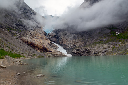 Briksdalsbreen is one of the best known arms of the Jostedalsbreen glacier. tilt Stock Photo