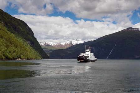 Mountains landscape and ferryboat sailing on fjord in Norway. Storfjorden as seen from ferry. Editorial