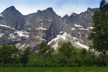 metres: The Troll Wall (Trollveggen) is part of the mountain massif Trolltindene on the Norwegian west coast. The Troll Wall is the tallest vertical rock face in Europe, about 1,100 metres from its base to the summit of its highest point