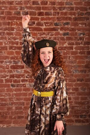 the Girl screams cheers in military dress