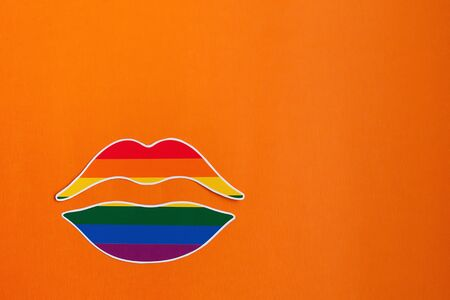 the rainbow lips on an orange background