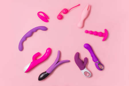 on a pink background sex product, a toy for adults Stock Photo