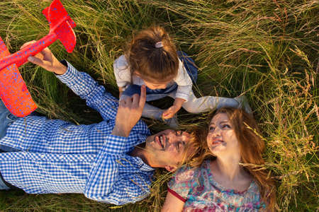 Happy family relaxes in nature view from above