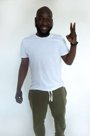 the happy African American against the white wall