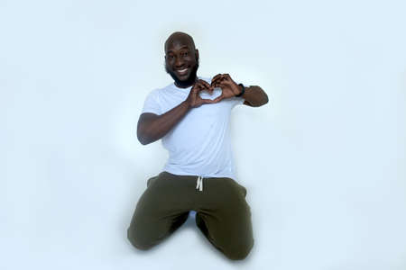 the African American shows gesture with his heart
