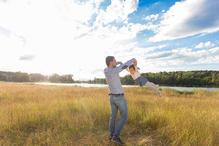 the Dad with little daughter in nature, having fun