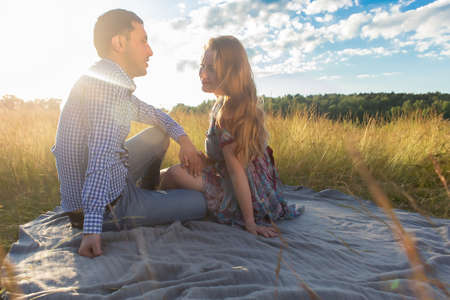 the couple in love on nature in the rays of the sun