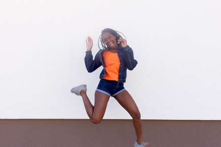 the Happy African American woman jumps and dances