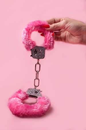 on a pink background sex product, a toy for adults 免版税图像