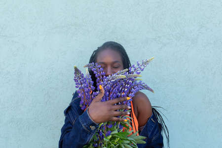 the beautiful African American with flowers