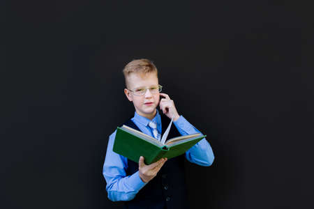 the boy in school uniform with books back to school