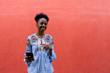 the beautiful and happy African American with phone