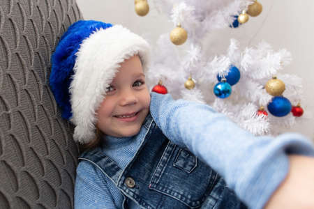the Little girl takes a selfie on Christmas Day