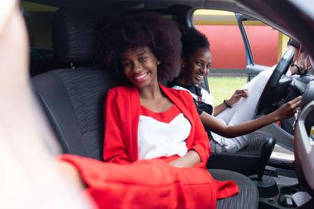 the two African American women having fun in the car