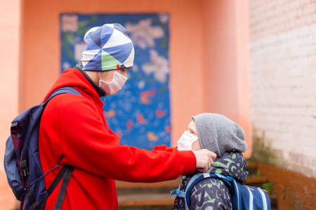 the Schoolboy corrects friend protective mask 写真素材