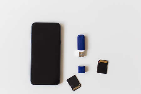 the phone and flash drive on a white background