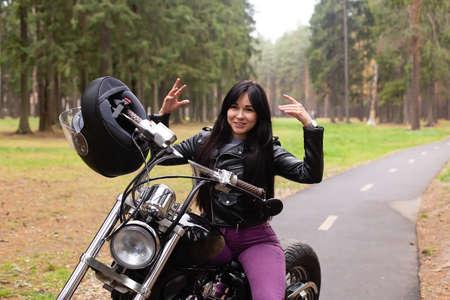 Happy girl on a motorcycle Archivio Fotografico