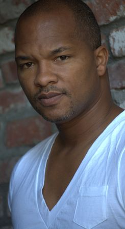 Portrait of a black man wearing white t-shirt Banco de Imagens