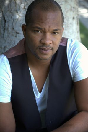 Portrait of a black man wearing a vest