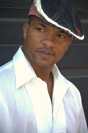 Portrait of a black man wearing white shirt Stock Photo