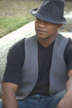 Black man wearing hat