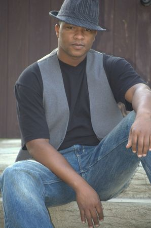 Portrait of a black man wearing hat and vest Stock Photo
