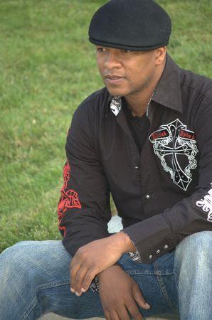 Stylish black man wearing black hat