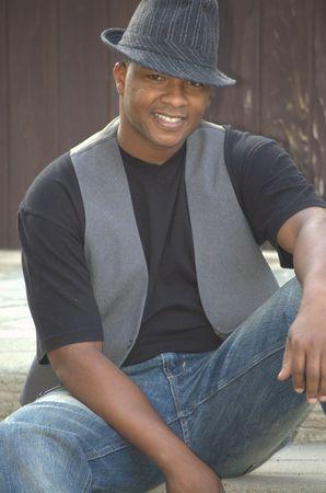 Smiling black man wearing a hat Stock Photo