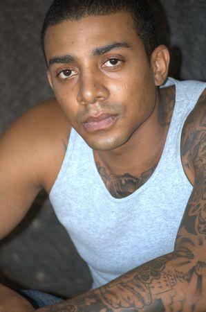 Tough black man with tattoos Stock Photo
