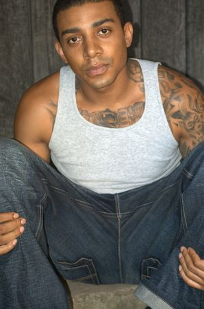 an inmate: Portrait of a young black man with tattoos