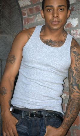 Tough black man with tattoos standing