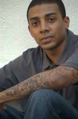 Portrait of a black man with tattoos