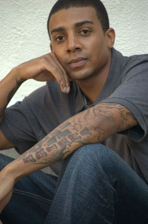 Portrait of a young black man with tattoos