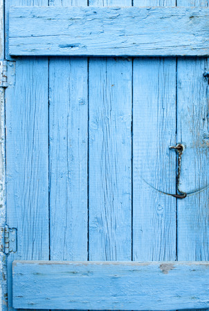 Old door of blue boards with lock and hook photo