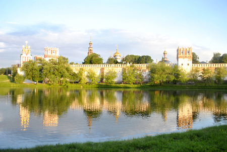 View of the Chapel of the Novodevichy Convent and pond with birds photo