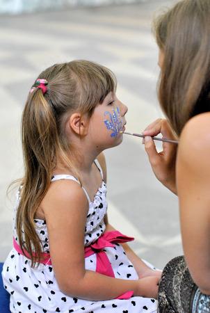 Wizard girl draws paint makeup photo