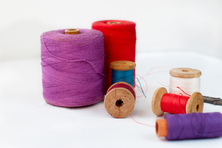 Many different Spool, scissors and centimeter of thread. Sew accessories photo