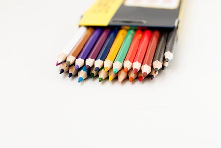 diagonals: School color pencils lie on a white background