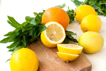 minty: lemon on a chopping board and mint leaves