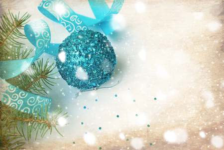 turquoise: branch of a Christmas tree and blue ball and ribbon Christmas card