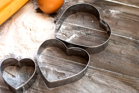 bakeware: Cake pans hearts and round metal bakeware, wooden rolling pin on a wooden background cookies Valentines Day