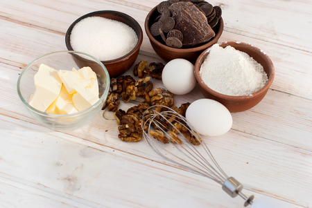 chocolate cakes: flour, butter, sugar, eggs, chocolate - ingredients for a batch of homemade chocolate cake brownie