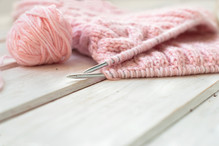 Skeins of wool and knitting needles on a wooden background Stok Fotoğraf