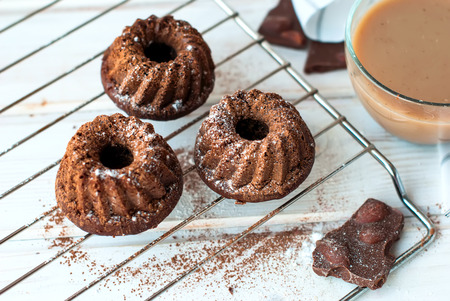 baking powder: chocolate cupcakes sprinkled with cocoa and baking powder on a lattice