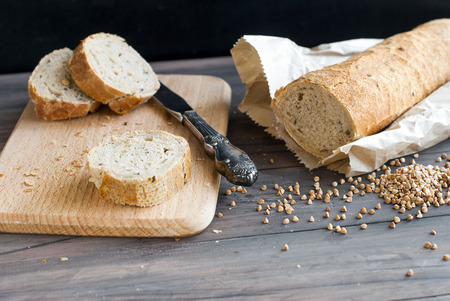 nigella seeds: Natural homemade seeds and buckwheat bread on the wooden Board Stock Photo
